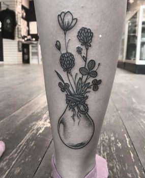 Light bulb and flowers tattoo by Jade